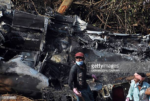 Indian labourers work at the plane crash site of the Air India Express Boeing 737800 in Mangalore on May 24 2010 Investigators combed the wreckage of...