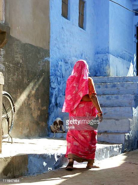 indian lady in pink sarong walking in Jodhpur,India