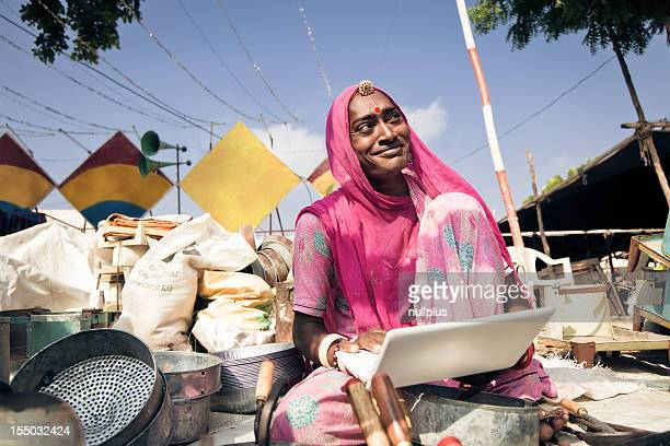 indian lady selling her pots on the internet