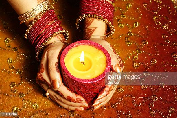Indian lady with candle celebrating
