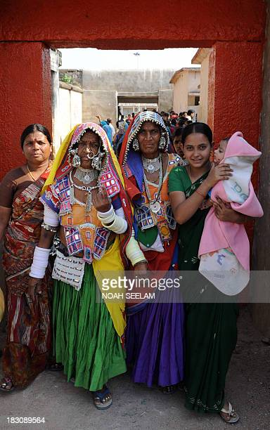 Indian Lambadi tribal women walk out of a polling booth after casting their votes at Rangareddy District on the outskirts of Hyderabad on April 16...