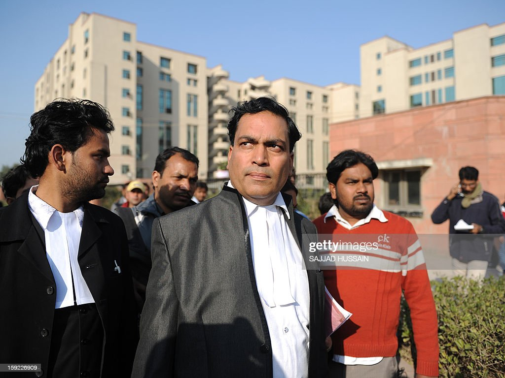 Indian lawyer Ajay Prakash Singh (C), who represents defendants Akshay Thakur and Vinay Sharma who are on trial for the gang-rape of a student, speaks with the media outside the Saket District Court in New Delhi on January 10 ,2013. A lawyer for the defendants in the New Delhi gang-rape case accused police on January 10 of beating confessions out of them as they appeared for their second court appearance.