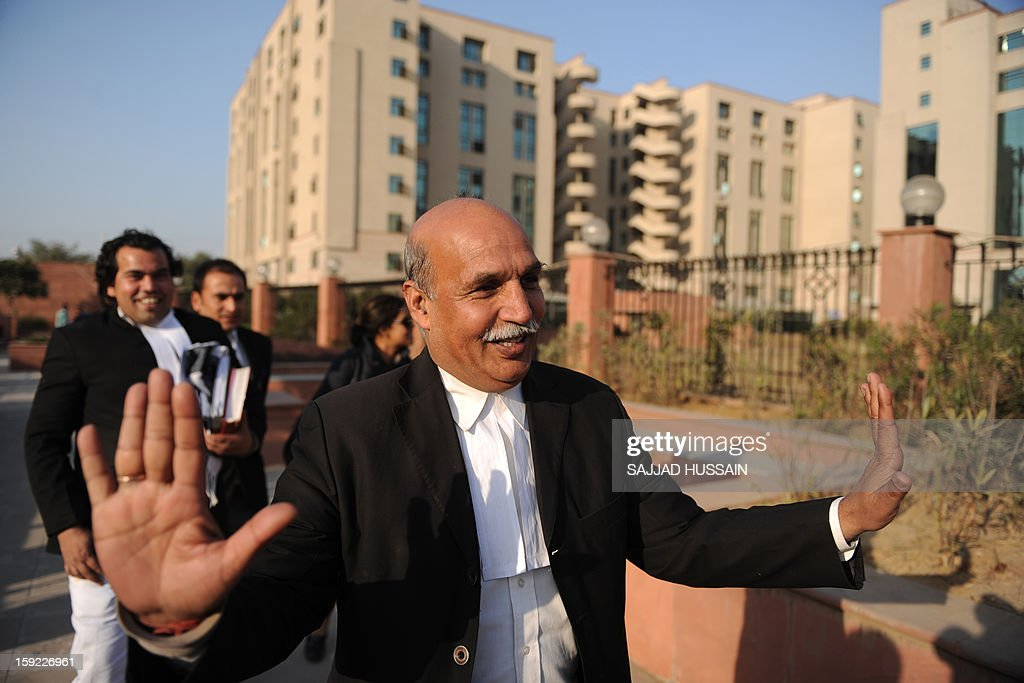 Indian lawyer V.K. Anand, who represents defendant Ram Singh who is on trial for the gang-rape of a student, gestures as he speaks with the media outside the Saket District Court in New Delhi on January 10, 2013. A lawyer for the defendants in the New Delhi gang-rape case accused police on January 10 of beating confessions out of them as they appeared for their second court appearance.