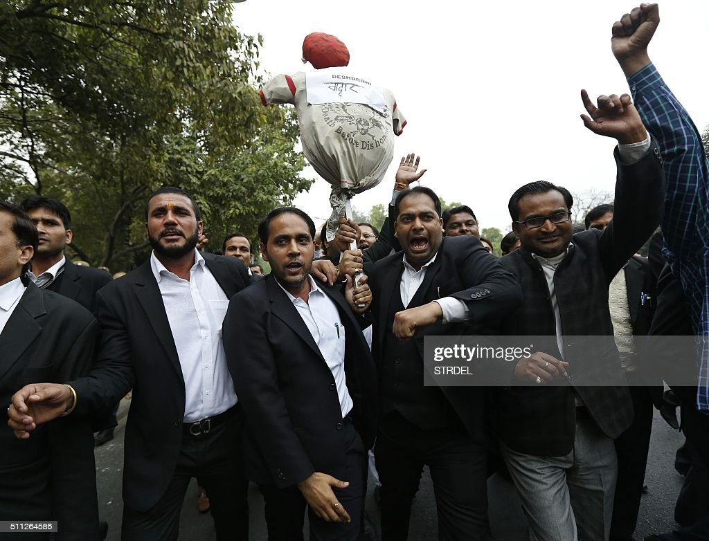 Indian lawyers shout slogans and carry an effigy as they take part in a demonstration in New Delhi on February 19, 2016. Hundreds of lawyers marched through the streets of the Indian capital February 19 pledging to attack anyone found to be 'anti-national', after some were accused of assaulting a student arrested for sedition.