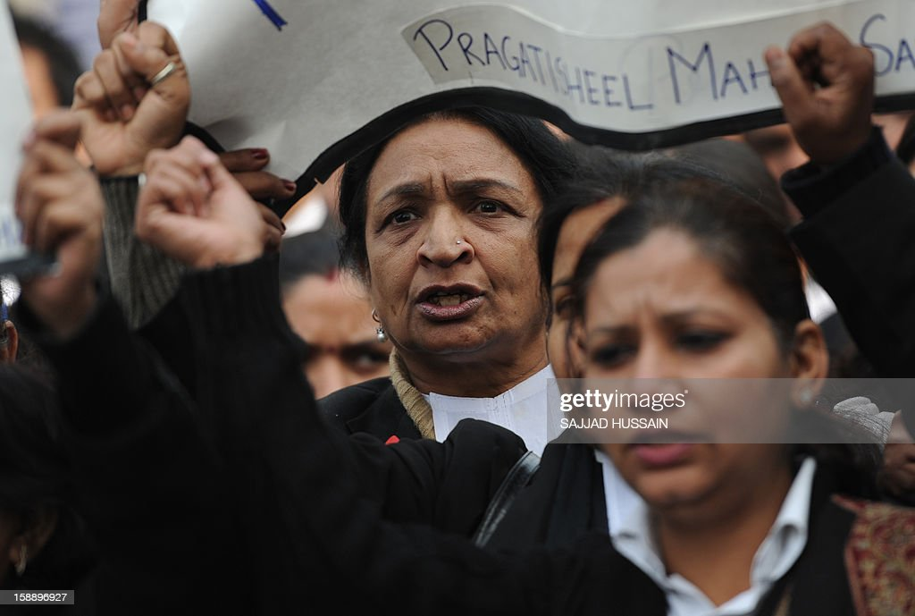 Indian lawyers shout slogans as they hold placards during a protest at the entrance to Saket District Court in New Delhi on January 3, 2013. A gang of men accused of repeatedly raping a 23-year-old student on a moving bus in New Delhi in a deadly crime that repulsed the nation are to appear in court for the first time. Police are to formally charge five suspects with rape, kidnapping and murder after the woman died at the weekend from the horrific injuries inflicted on her during an ordeal that has galvanised disgust over rising sex crimes in India