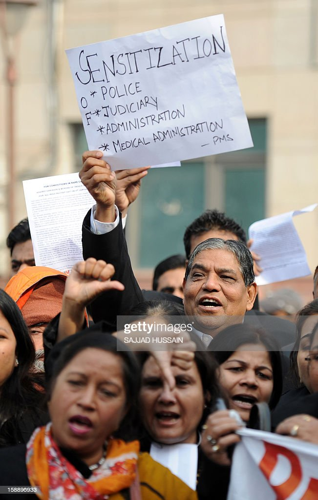 Indian lawyers shout slogans as they hold placards during a protest at the entrance to Saket District Court in New Delhi on January 3, 2013. A gang of men accused of repeatedly raping a 23-year-old student on a moving bus in New Delhi in a deadly crime that repulsed the nation are to appear in court for the first time. Police are to formally charge five suspects with rape, kidnapping and murder after the woman died at the weekend from the horrific injuries inflicted on her during an ordeal that has galvanised disgust over rising sex crimes in India AFP PHOTO/SAJJAD HUSSAIN