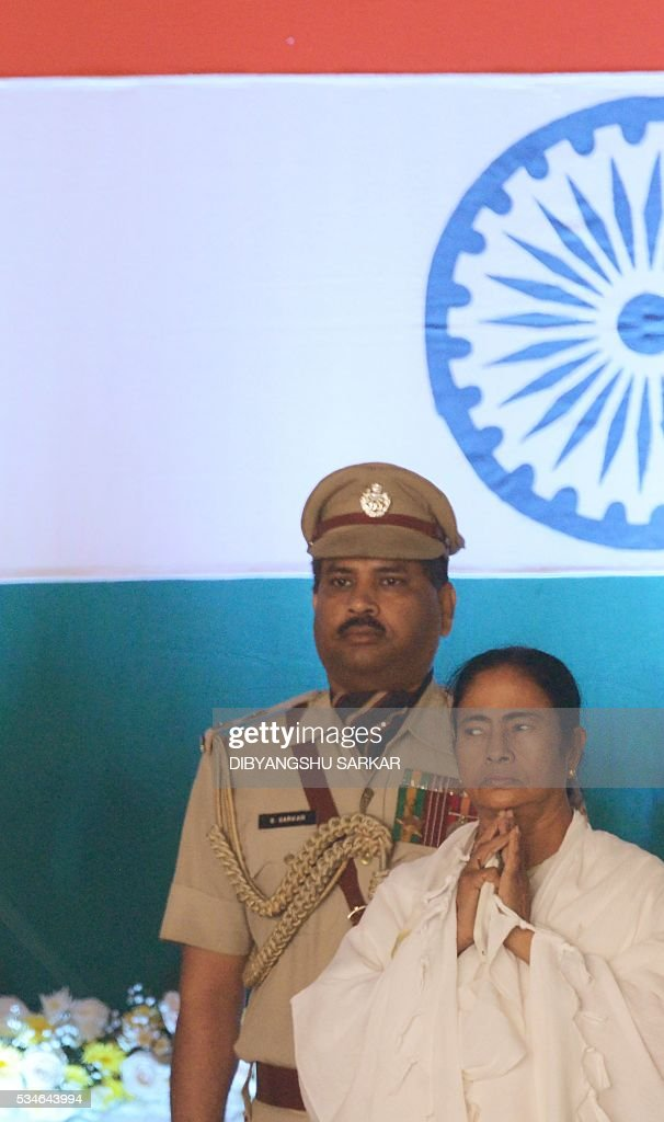 Indian leader of the All India Trinamool Congress (AITMC) Mamata Banerjee looks on during her swearing-in ceremony as chief minister of the eastern Indian state of West Bengal in Kolkata on May 27, 2016. / AFP / Dibyangshu SARKAR
