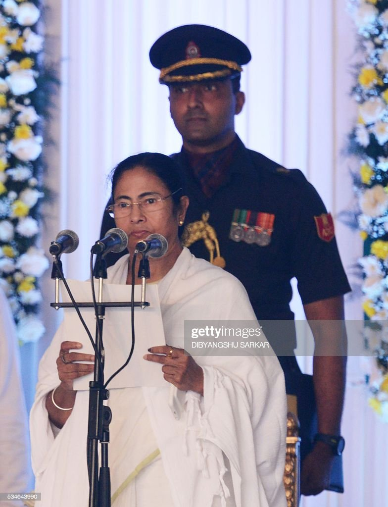Indian leader of the All India Trinamool Congress (AITMC) Mamata Banerjee speaks during her swearing-in ceremony as chief minister of the eastern Indian state of West Bengal in Kolkata on May 27, 2016. / AFP / Dibyangshu SARKAR