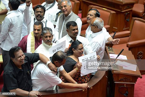 Indian leaders and members of the opposition in the Karnataka State Legislative Assembly stage a protest inside the Assembly Hall of the Vidhana...