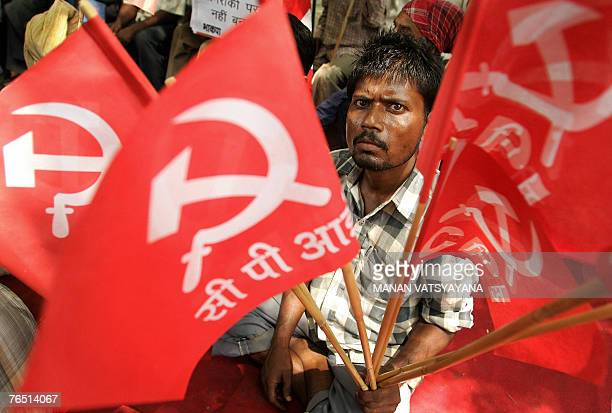 Indian Left activists shout slogans and hold Communist flags as they take part in a protest in New Delhi 05 September 2007 against a massive joint...