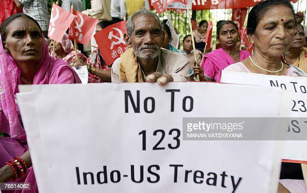 Indian Left activists shout slogans and hold placards as they take part in a protest in New Delhi 05 September 2007 against a massive joint naval...