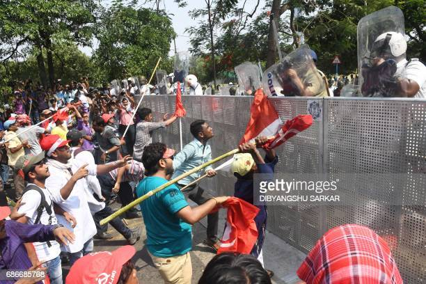 Indian Leftist activists try to breach a police barrier during a march towards the state secretariat in Kolkata on May 22 2017 Demonstrators and...