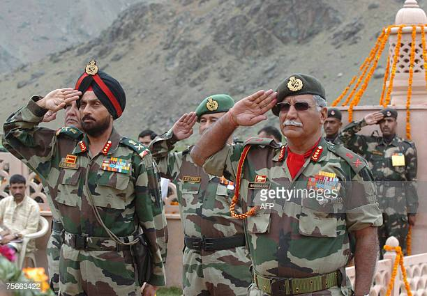 Indian Lieutenant General OP Nandrajog and seniro Indian Army officials salute at a war memorial during a wreath laying ceremony during 'Vijay Diwas'...