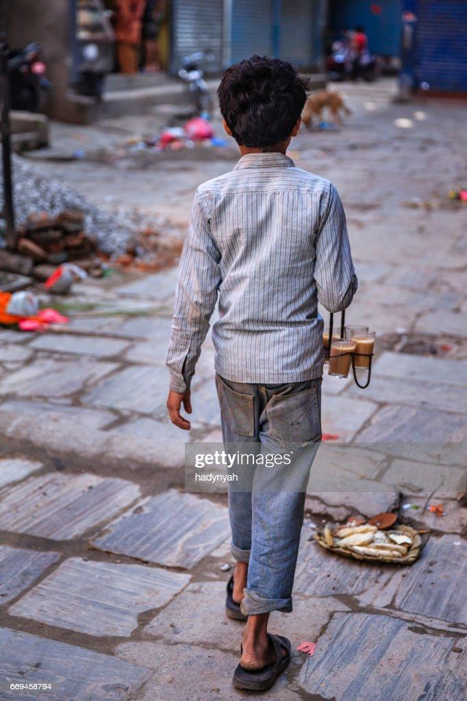 Indian little boy selling chai on streets of Kathmandu, Nepal : Stock Photo