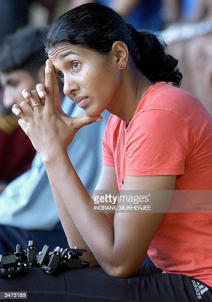 Indian long jumper Anju Bobby George takes a rest during a training session at the Sports Authority of India campus in Bangalore 27 April 2004 A...