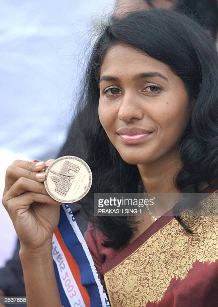 Indian long Jumper Anju George poses with her bronze medal during a felicitation ceremony at Jawahar lal Nehru stadium in New Delhi 16 September 2003...