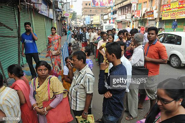 Indian long time waiting a long line Many Deposit and change old to new currency at Front of STATE BANK OF INDIA Salkiya HOWRAH Branch in Kolkata...