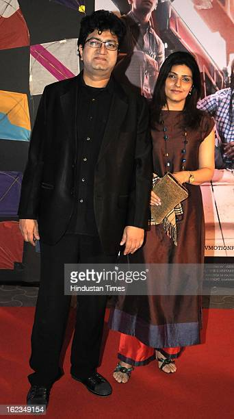 Indian lyricist screenwriter Prasoon Joshi with wife Aparna during the premiere of movie 'Kai Po Che' at Cinemax on February 18 2013 in Mumbai India