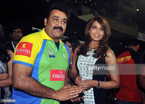 Indian Malayalam film actor Mohanlal and Bollywood film actress Bipasha Basu attend the Celebrity Cricket League 2013 Finals between Karnataka...