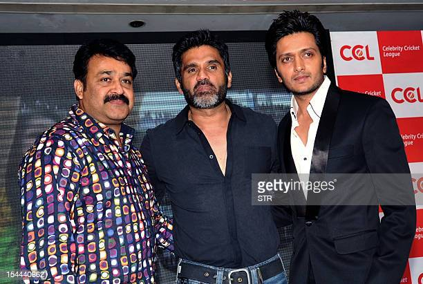 Indian Malayalam superstar Mohanlal Bollywood film actors Suniel Shetty and Riteish Deshmukh pose during the announcement of two new 'Celebrity...