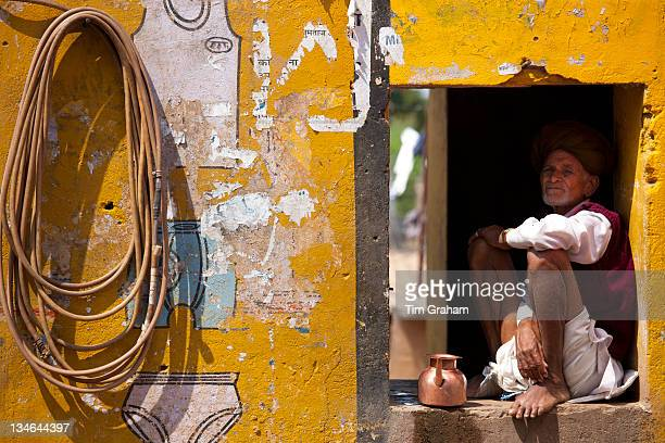 Indian man at his home and business at Ganesh Dham in Sawai Madhopur district in Rajasthan Northern India