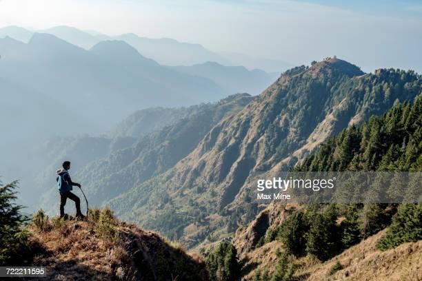 Indian man hiking on mountain