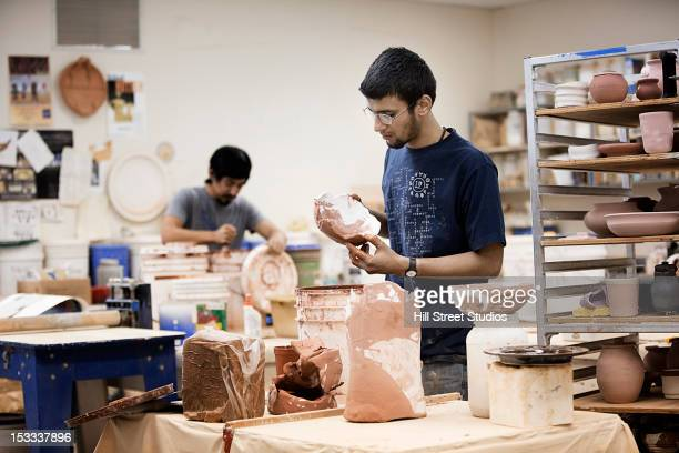 Indian man in pottery workshop