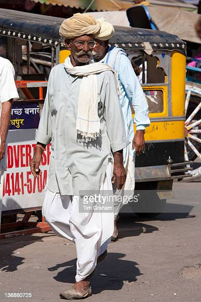 Indian man in traditional dhoti trousers and turban at Sardar Market at Girdikot Jodhpur Rajasthan Northern India