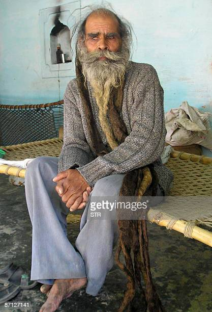 Indian man Kailash 'Kalau' Singh who reportedly has not taken a shower in 35 years looks on as he sits on a rope bed at a village in the outskirts of...