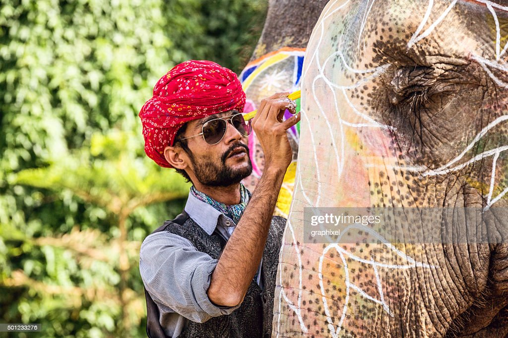 Indian Man Painting Elephant