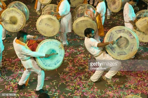 Indian Man playing musical instrument, Pune, Maharashtra, India, Asia
