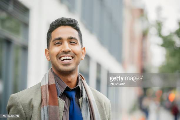 Indian man smiling in city