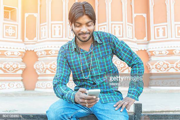 Indian Man Social Networking with Smart Phone in Jaipur