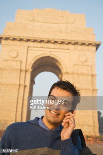 Indian man talking on cell phone near the India Gate : Stock Photo