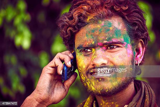 Indian Man Talking On The Mobile Phone During Celebrating Holi