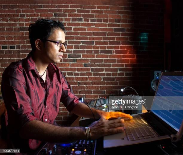Indian man typing on laptop
