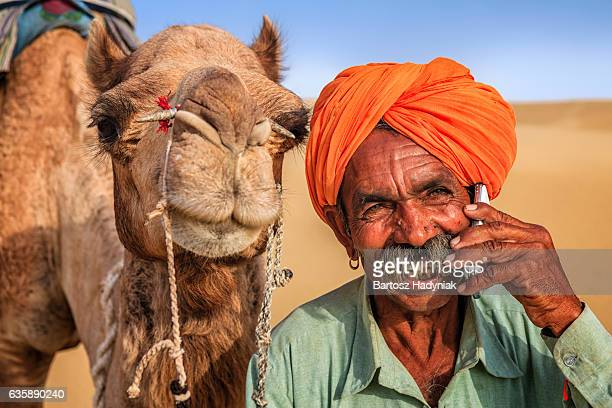 Indian man using a mobile, desert village, India