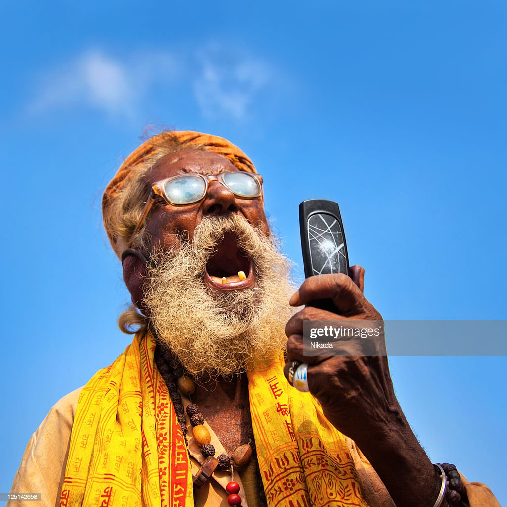 Indian man using a mobile : Stock Photo