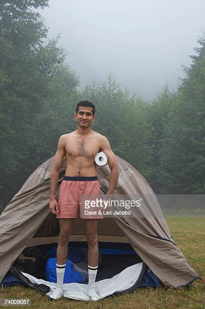 Indian man wearing boxer shorts at campsite