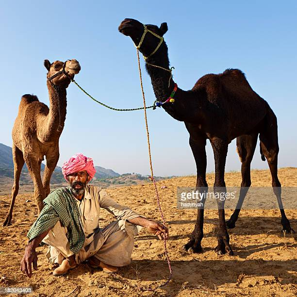 Indian man with camels during festival in Pushkar