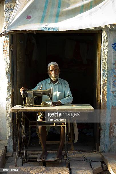Indian man with sewing machine in village of Rohet in Rajasthan Northern India