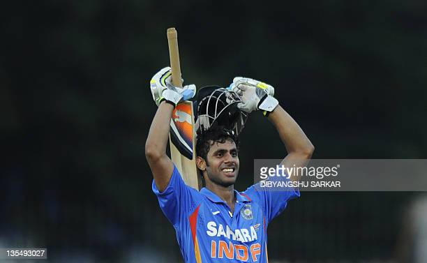 Indian Manoj Tiwary celebrates scoring a century during the final One Day International cricket match between India and West Indies at The...