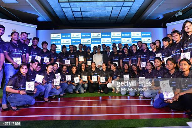 Indian medal winners in the 17th Asian Games in South Korea pose during an event in New Delhi on October 13 2014 Indian Olympic Association officials...