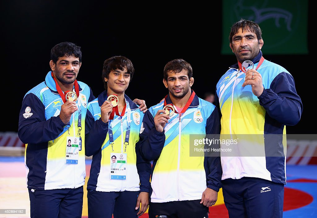 Indian medalists <a gi-track='captionPersonalityLinkClicked' href=/galleries/search?phrase=Sushil+Kumar&family=editorial&specificpeople=703954 ng-click='$event.stopPropagation()'>Sushil Kumar</a> (gold 74kg) Vinesh (gold 48kg) Amit Amit Kumar (gold 57kg) and Rajeev Tomar (silver 125kg) poses with their medals after the Freestyle Wrestling finals at Scottish Exhibition And Conference Centre during day six of the Glasgow 2014 Commonwealth Games on July 29, 2014 in Glasgow, United Kingdom.