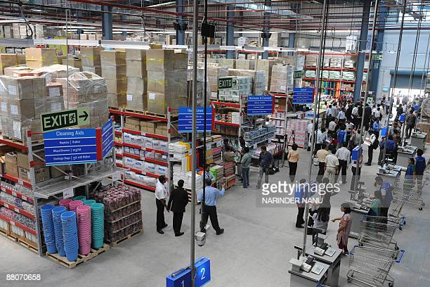Indian media representatives stand inside the country's first ever Bharti WalMart 'Best Price' Modern Wholesale cash and carry store in the village...