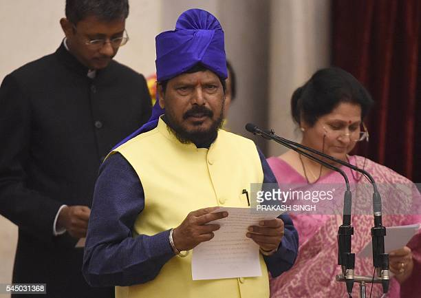 Indian member of Parliament Ramdas Athawale takes the oath during the swearingin ceremony of new ministers following Prime Minister Narendra Modi's...