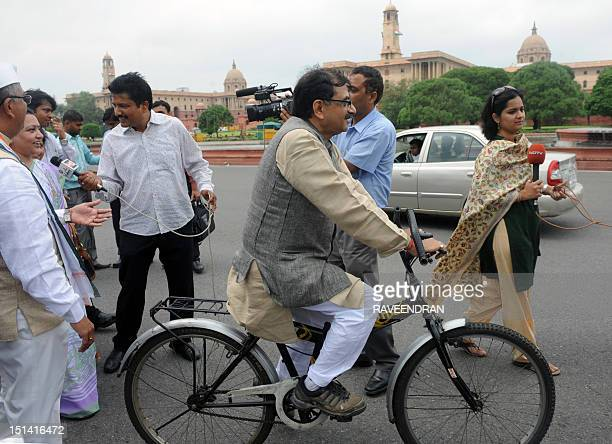 Indian Member of Parliament Tarun Vijay heads to parliament on a bicycle to raise awareness on health and pollution issues in New Delhi on September...