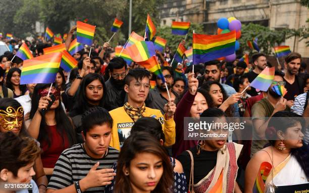 Indian members and supporters of the lesbian gay bisexual transgender community take part in a pride parade in New Delhi on November 12 2017 Hundreds...
