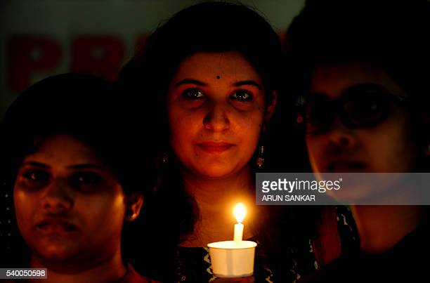 Indian members of LGBT community observe a candlelight vigil to pay tribute to victims of a massacre at a gay club in the US city of Orlando in...