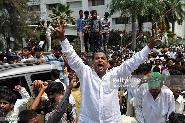 Indian members of MajliseIttehadul Muslimeen party shout slogans outside the Owaisi Hospital in Hyderabad on April 30 where their leader and Member...